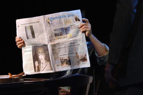 39-Stufen-Zeitung-am-Tisch_141106_imagelarge